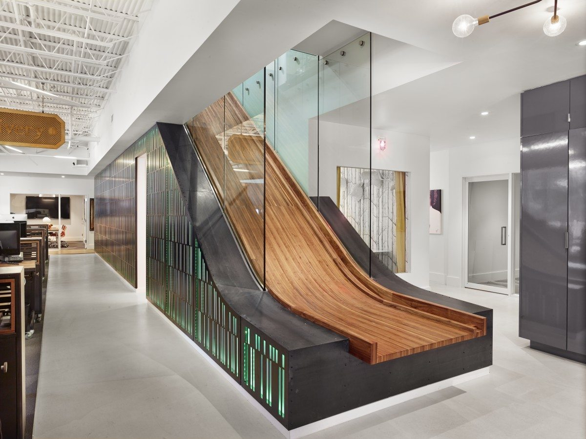 Take a tour of thechive s awesome austin headquarters for Escalier interieur moderne