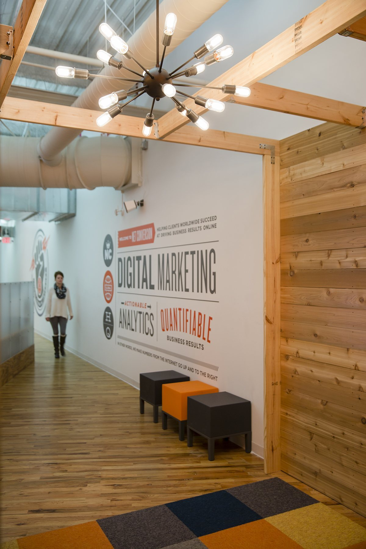 A tour of net conversion s trendy orlando office for Office branding ideas