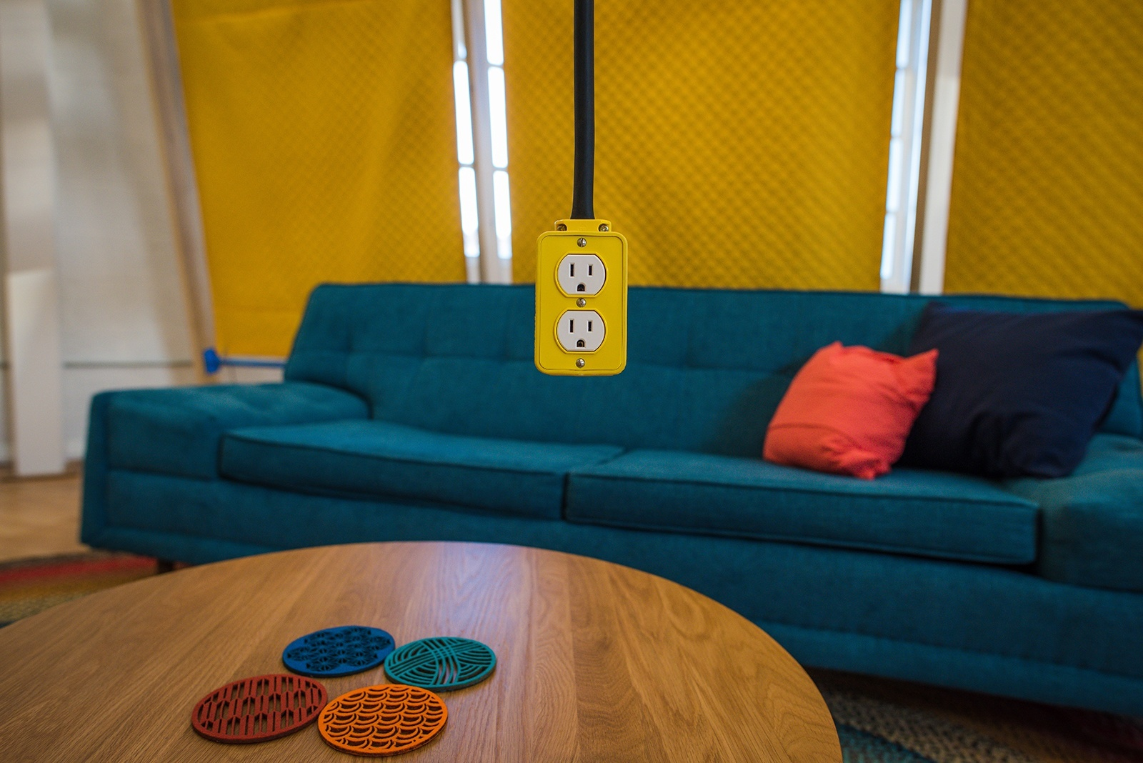 pictures to hang in office. bright yellow outlets hang from the ceiling, providing power and a colorful, industrial touch pictures to in office l