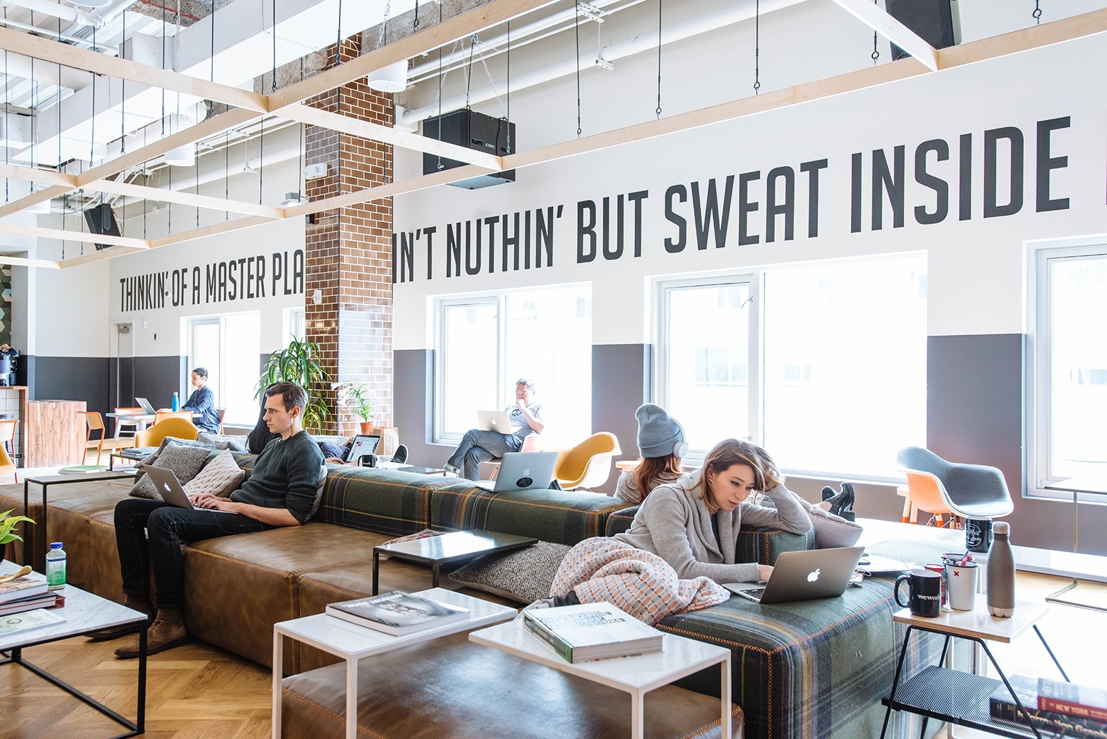 A look inside wework s williamsburg coworking space for Office working area design